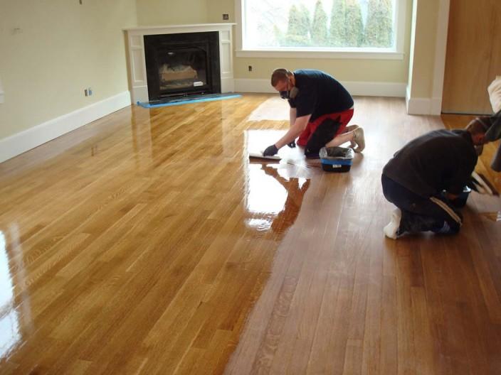 Flooring Contractors Finishing A Wood Flooring Installation Project
